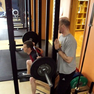 Jay Tieder instructing weightlifting