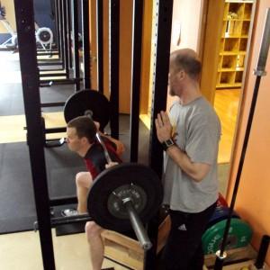 Jay Tieder instructing weightlifting