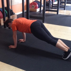 Christy Plank at the top of a Push-up Bridgetown Barbell Basic Strength and Conditioning Program