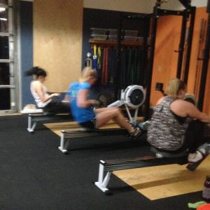 2 women rowing on ergs at Bridgetown crossfit ad barbell club Portland OR